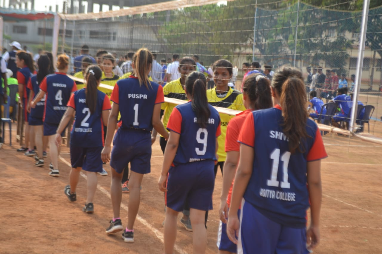 Aditya Volleyball Team members shake handing with opposite team